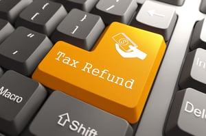 Tax Refund - Orange Button on Computer Keyboard. Internet Concept.